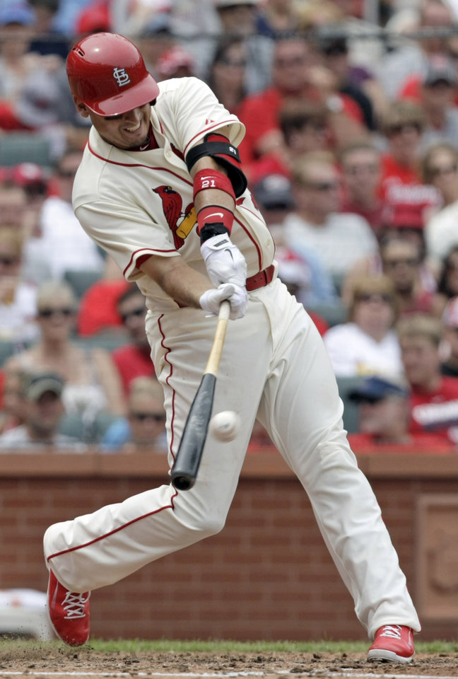 Photo - St. Louis Cardinals' Allen Craig connects for a two-run home run in the fourth inning of a baseball game against the Miami Marlins, Saturday, July 5, 2014, in St. Louis.(AP Photo/Tom Gannam)