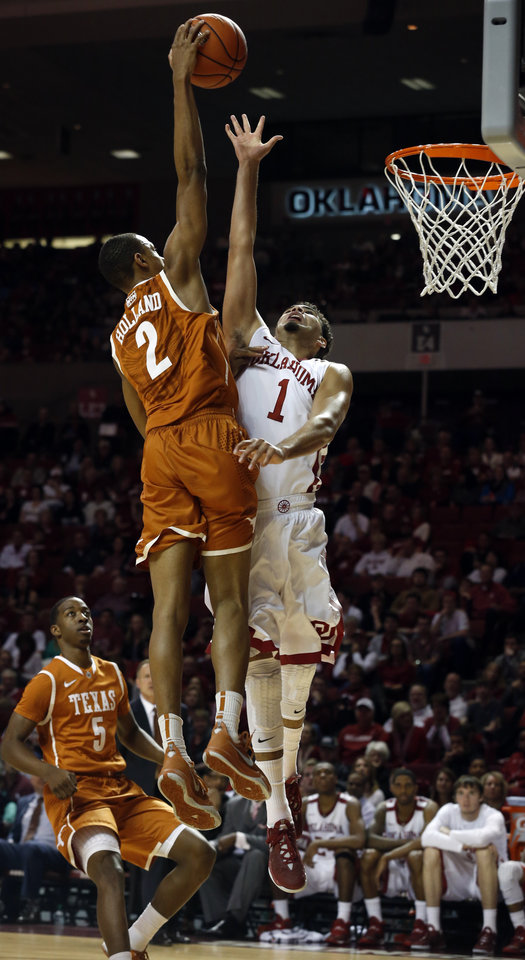 Photo - Oklahoma Sooner Frank Booker (1) is called for a foul as he blocks a shot by Demarcus Holland as the University of Oklahoma Sooners (OU) men play the Texas Longhorns (TU) in NCAA, college basketball at The Lloyd Noble Center on Saturday, March 1, 2014  in Norman, Okla. Photo by Steve Sisney, The Oklahoman