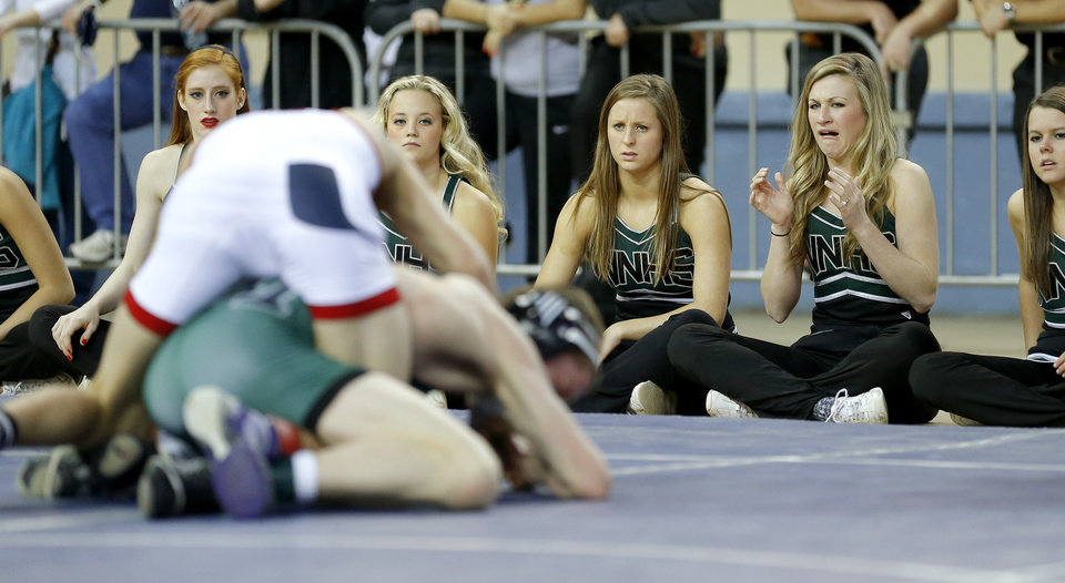 Norman North cheerleaders react during a wrestling match in the state wrestling championships at the State Fair Arena in Oklahoma City, Saturday, Feb. 23, 2013. Photo by Bryan Terry, The Oklahoman