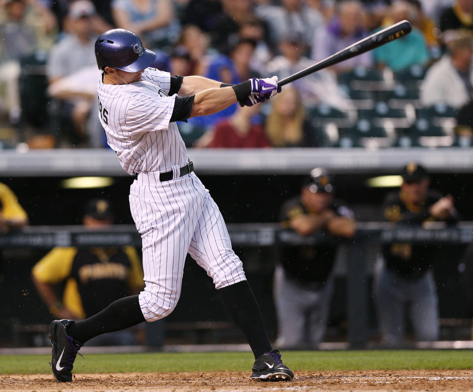 Photo - Colorado Rockies' Drew Stubbs follows the flight of his solo home run against the Pittsburgh Pirates in the fourth inning of a baseball game in Denver, Saturday, July 26, 2014. (AP Photo/David Zalubowski)