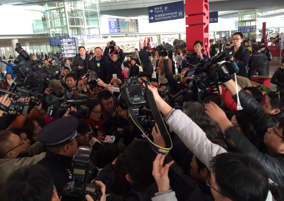 Photo - In this photo released by China's Xinhua News Agency, reporters crowd at Terminal 3 of Beijing Capital International Airport in Beijing, China Saturday, March 8, 2014 following a report that a Malaysia Airlines Boeing 777-200 lost contact on a flight from Kuala Lumpur to Beijing. (AP Photo/Xinhua, Luo Xiaoguang) NO SALES