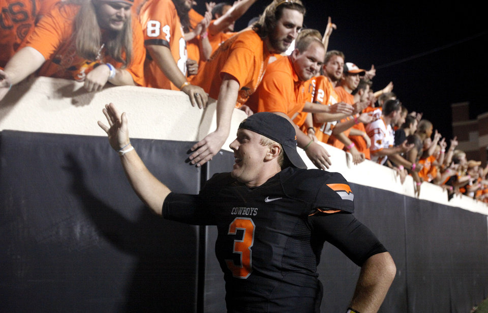 Photo - Oklahoma State's Brandon Weeden (3) gives fans high fives following a college football game between the Oklahoma State University Cowboys (OSU) and the University of Arizona Wildcats at Boone Pickens Stadium in Stillwater, Okla., Thursday, Sept. 8, 2011. Photo by Sarah Phipps, The Oklahoman  ORG XMIT: KOD