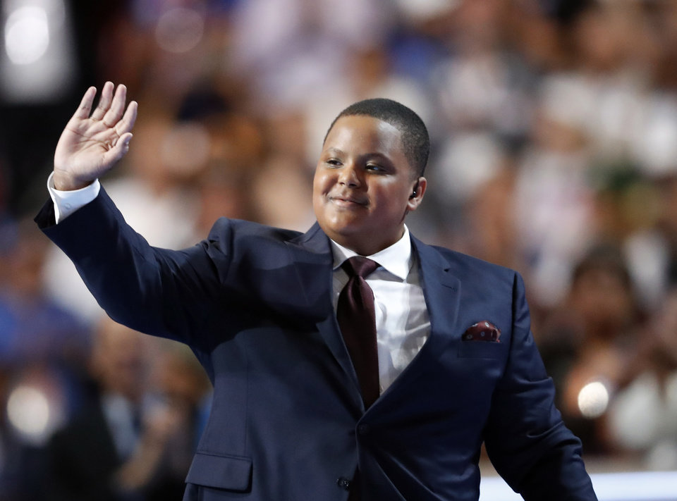 Photo - Bobby Hill waves after singing the National Anthem during the first day of the Democratic National Convention in Philadelphia , Monday, July 25, 2016. (AP Photo/Paul Sancya)
