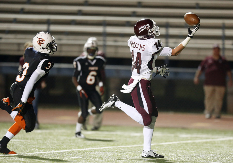 Trey Michalczewski of Jenks catches a touchdown pass in front of Putnam City's J.D. Clark during their high school game at Putnam City in Warr Acres, Okla., Thursday, Nov. 1, 2012. Photo by Bryan Terry, The Oklahoman