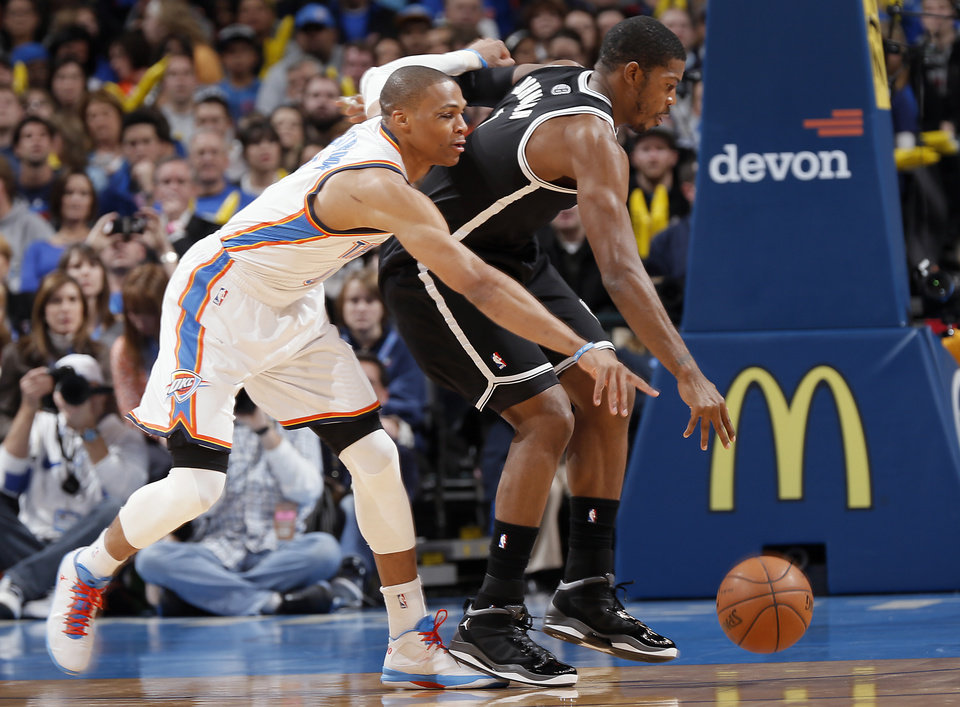 Oklahoma City's Russell Westbrook (0) defends on Brooklyn Nets' Joe Johnson (7) during the NBA basketball game between the Oklahoma City Thunder and the Brooklyn Nets at the Chesapeake Energy Arena on Wednesday, Jan. 2, 2013, in Oklahoma City, Okla. Photo by Chris Landsberger, The Oklahoman