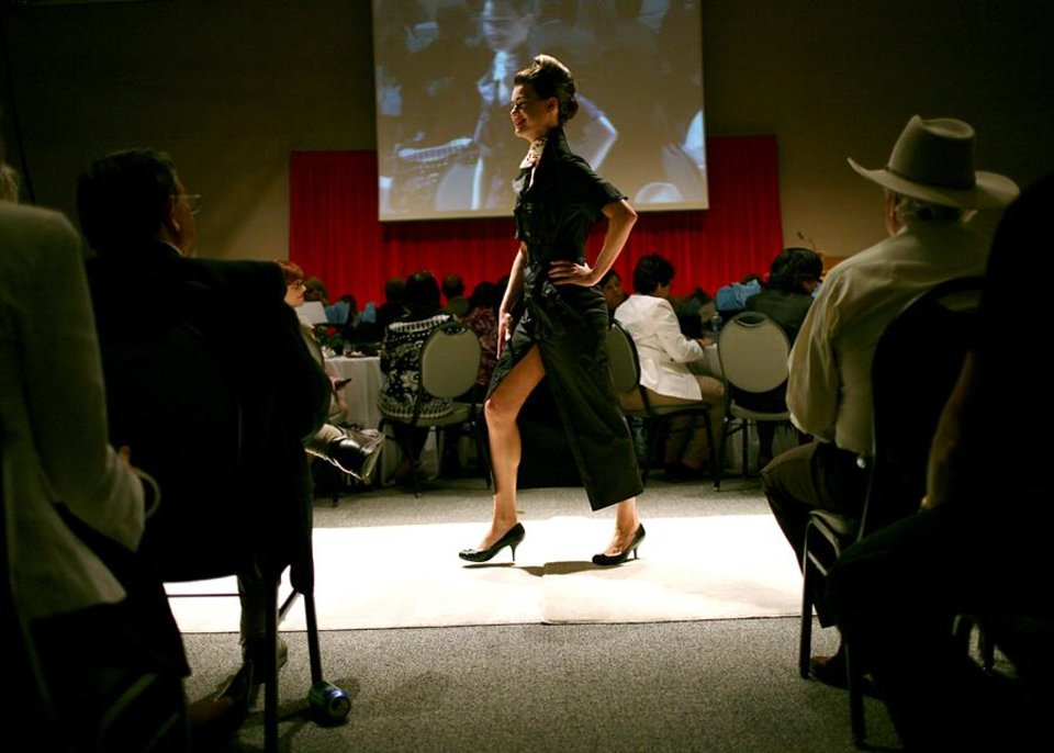 Photo -  A model walks down the runway during a fashion show called Insight, a celebration of Culture and Style at National Cowboy and Western Heritage Museum in Oklahoma City on Tuesday, July 19, 2011. The show featured modern styles inspired by traditional Afghan and Rwandan attire. Students from Oklahoma State University designed and created some of the clothing featured in the show. All proceeds from the event benefit The Institute for Economic Empowerment of Women and their program called Peace Through Business. Photo by John Clanton, The Oklahoman