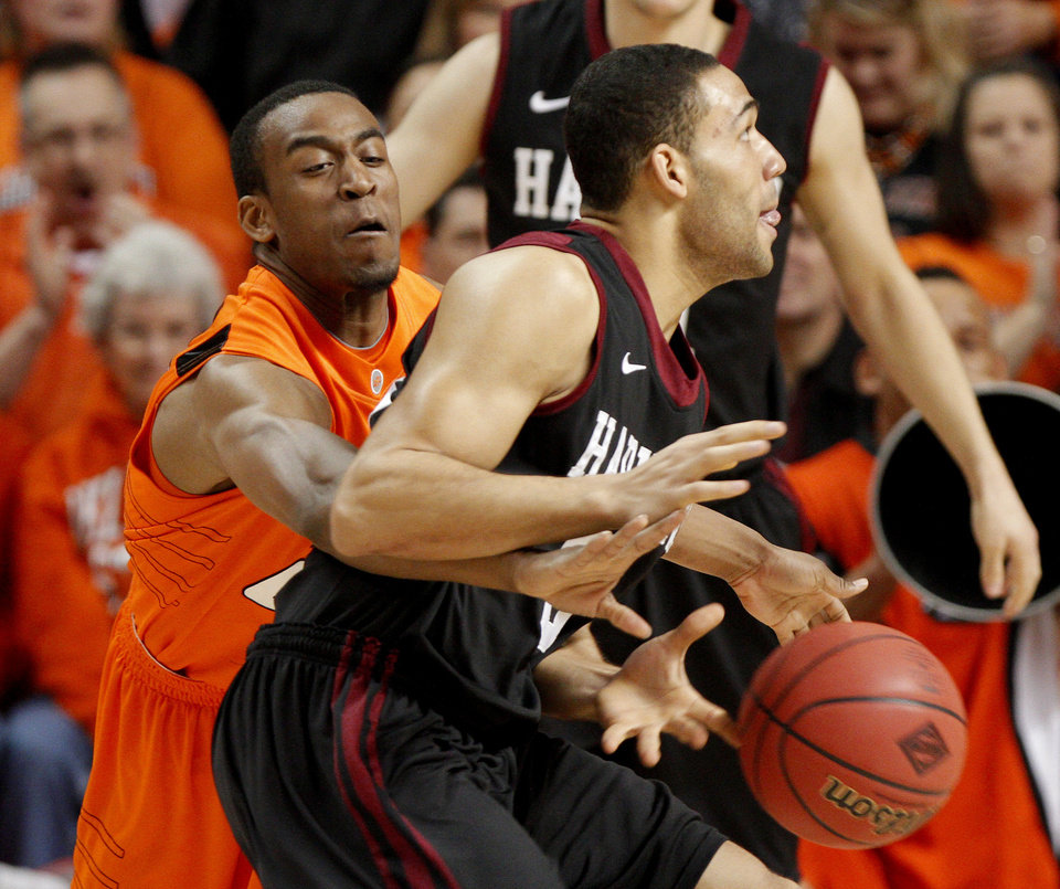Oklahoma State's Markel Brown (22) knocks the ball away from Harvard's Matt Brown (3) during a first-round NIT college basketball game between Oklahoma State University (OSU) and Harvard at Gallagher-Iba Arena in Stillwater, Okla., Tuesday, March 15, 2011. Photo by Bryan Terry, The Oklahoman