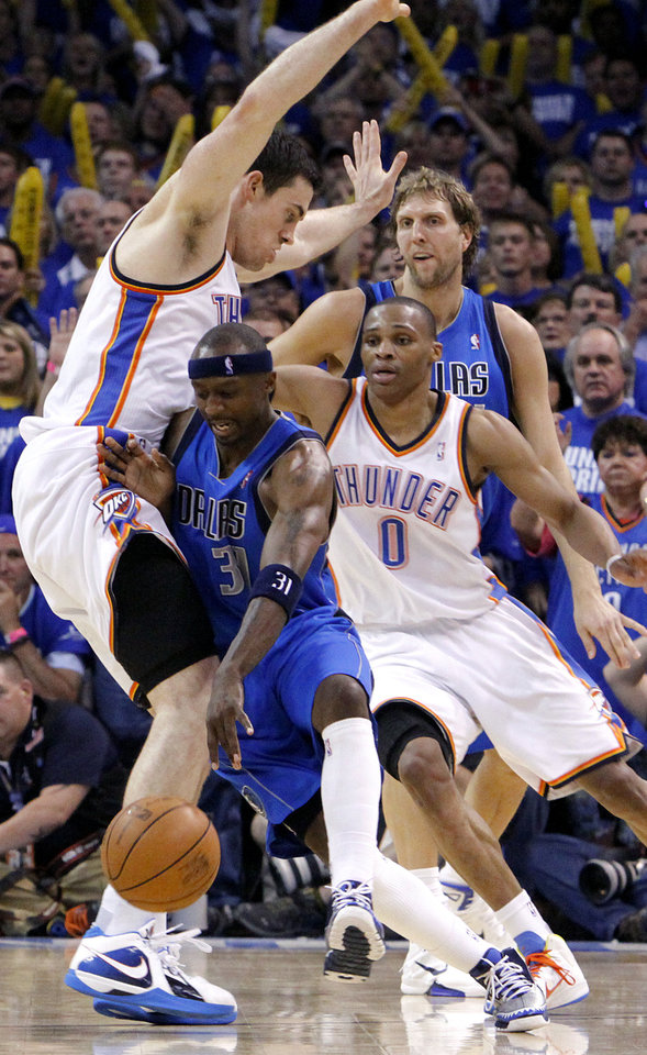 Jason Terry (31) of Dallas collides with Oklahoma City's Nick Collison (4) during game 3 of the Western Conference Finals of the NBA basketball playoffs between the Dallas Mavericks and the Oklahoma City Thunder at the OKC Arena in downtown Oklahoma City, Saturday, May 21, 2011. Photo by Chris Landsberger, The Oklahoman