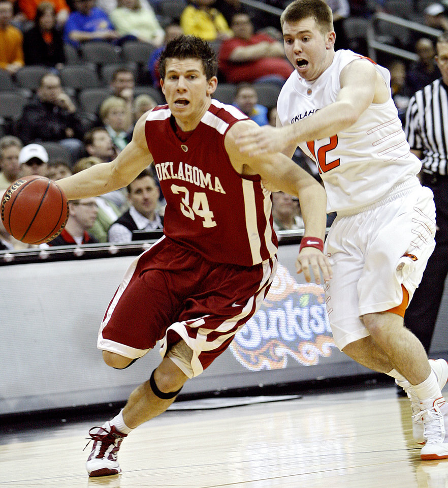 Photo - Oklahoma's Cade Davis (34) drives past Oklahoma State's Keiton Page (12) in the first half of the college basketball game during the men's Big 12 Championship tournament at the Sprint Center on Wednesday, March 10, 2010, in Kansas City, Mo. Photo by Chris Landsberger, The Oklahoman