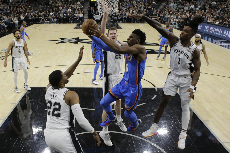 Photo - Oklahoma City Thunder guard Hamidou Diallo (6) drives to the basket against San Antonio Spurs forward Rudy Gay (22), and guard Lonnie Walker IV (1) during the first half of an NBA basketball game, in San Antonio, Thursday, Jan. 2, 2020. (AP Photo/Eric Gay)