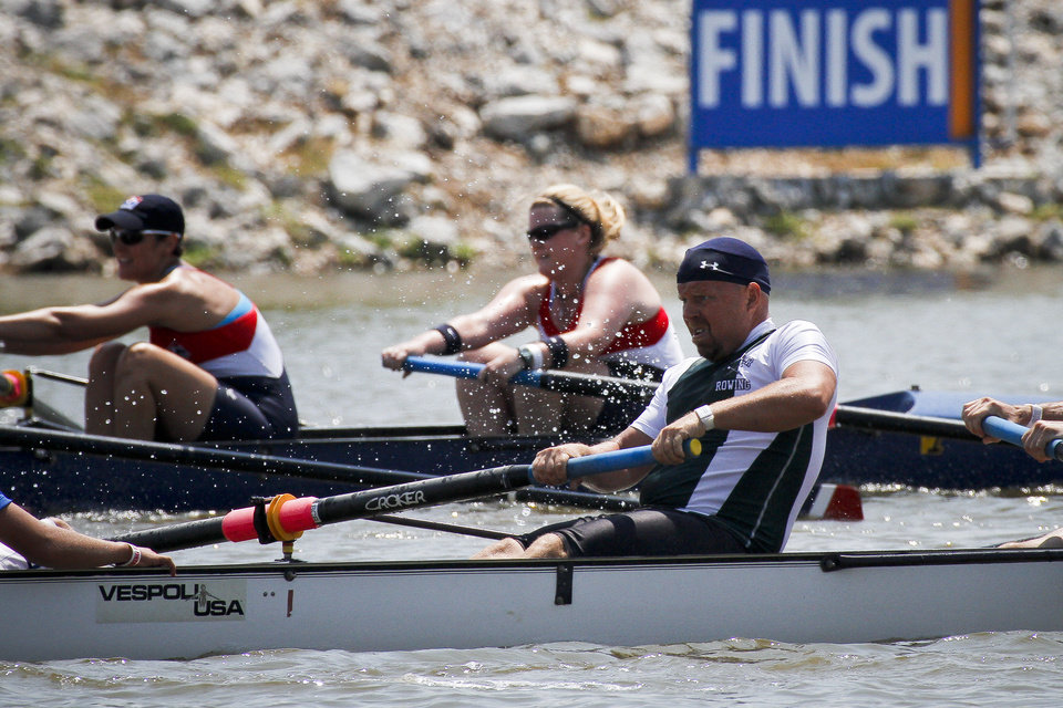 Photo - Teams from Boulder and Capital A battle for first in the Mixed B 8+ race during the USRowing Masters National Championships on the Oklahoma River on Friday, Aug. 12, 2011. Photo by Zach Gray, The Oklahoman