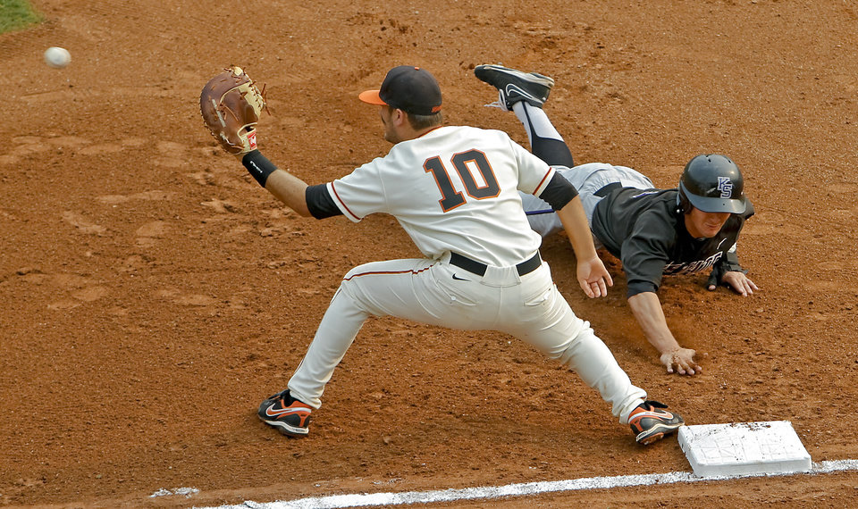 Photo - Oklahoma State's Wes Jones (10) tries to get the pick off of Kansas State's Tanner Witt (5) at first base during the Big 12 baseball tournament game between Oklahoma State University  and Kansas State University at the Chickasaw Bricktown Ballparkon Thursday, May 24, 2012, in Oklahoma City, Oklahoma. Photo by Chris Landsberger, The Oklahoman