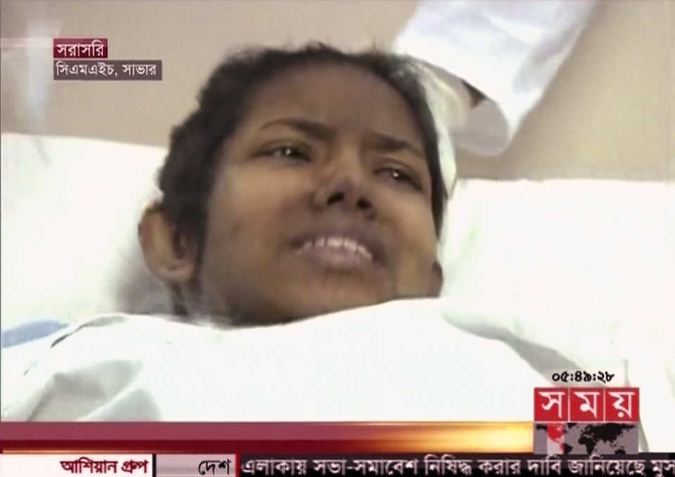 Photo - In this image taken from a TV footage released by AP video, a woman survivor lies down on a hospital bed in Dhaka as she was rescued out of a collapsed building in Savar near Dhaka, Bangladesh, Friday, May 10, 2013. The woman buried in the wreckage of a collapsed garment factory building for 17 days was rescued Friday, a miraculous moment set against a scene of unimaginable horror where the death toll is more than 1,000 and still rising. (AP Photo/Somoy TV via AP Video) BANGLADESH OUT