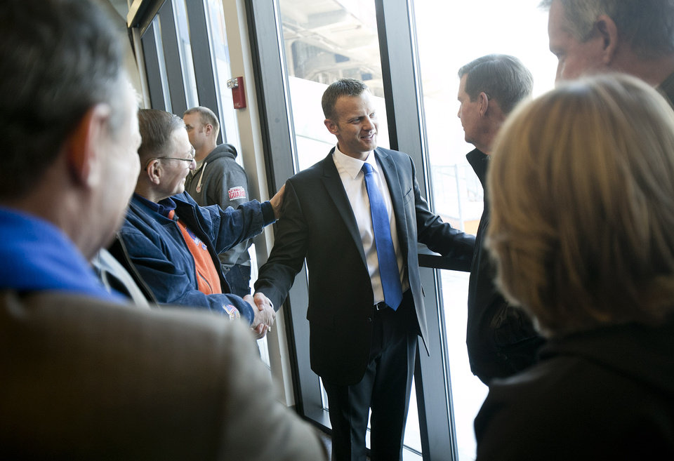 Photo - Boise State's new head coach Bryan Harsin smiles while talking with  supporters after his introduction at an NCAA college football news Conference Friday, Dec. 13, 2013, in Boise, Idaho. (AP Photo/The Idaho Statesman, Kyle Green) MANDITORY CREDIT; LOCAL TV OUT