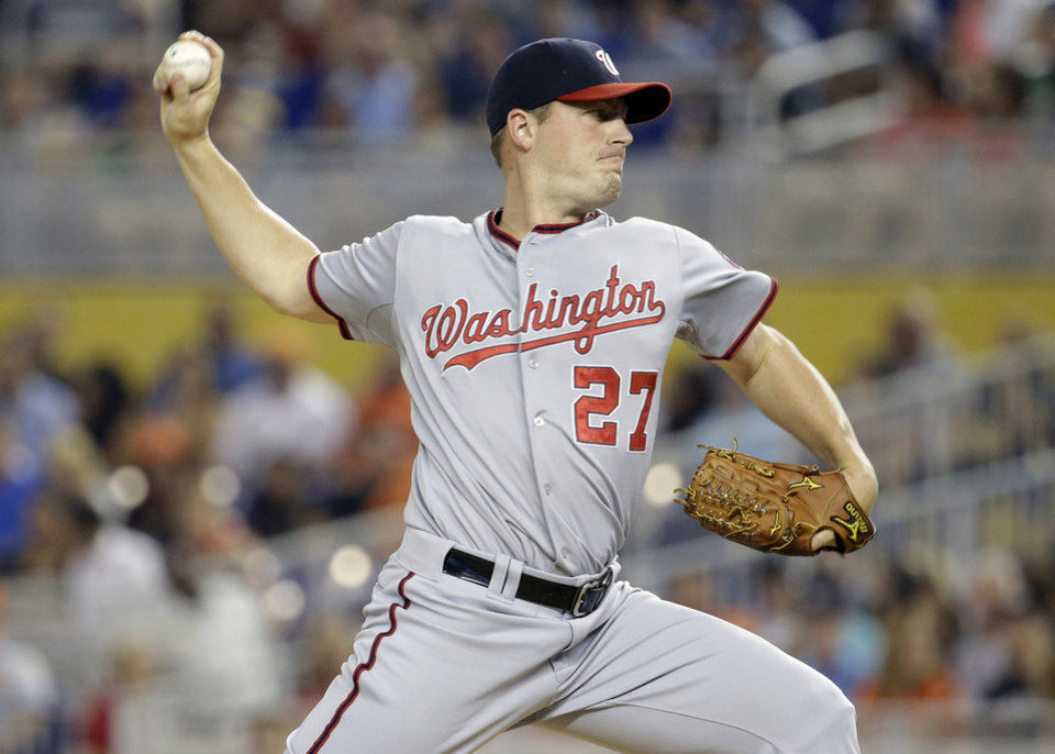 Photo - Washington Nationals starting pitcher Jordan Zimmermann (27) throws in the first inning during a baseball game against the Miami Marlins, Monday, July 28, 2014, in Miami. (AP Photo/Lynne Sladky)