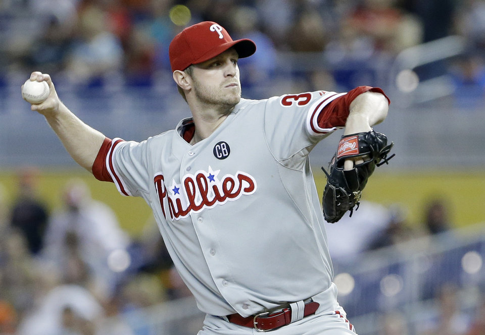 Photo - Philadelphia Phillies' Kyle Kendrick delivers a pitch during the first inning of a baseball game against the Miami Marlins, Thursday, July 3, 2014 in Miami. (AP Photo/Wilfredo Lee)