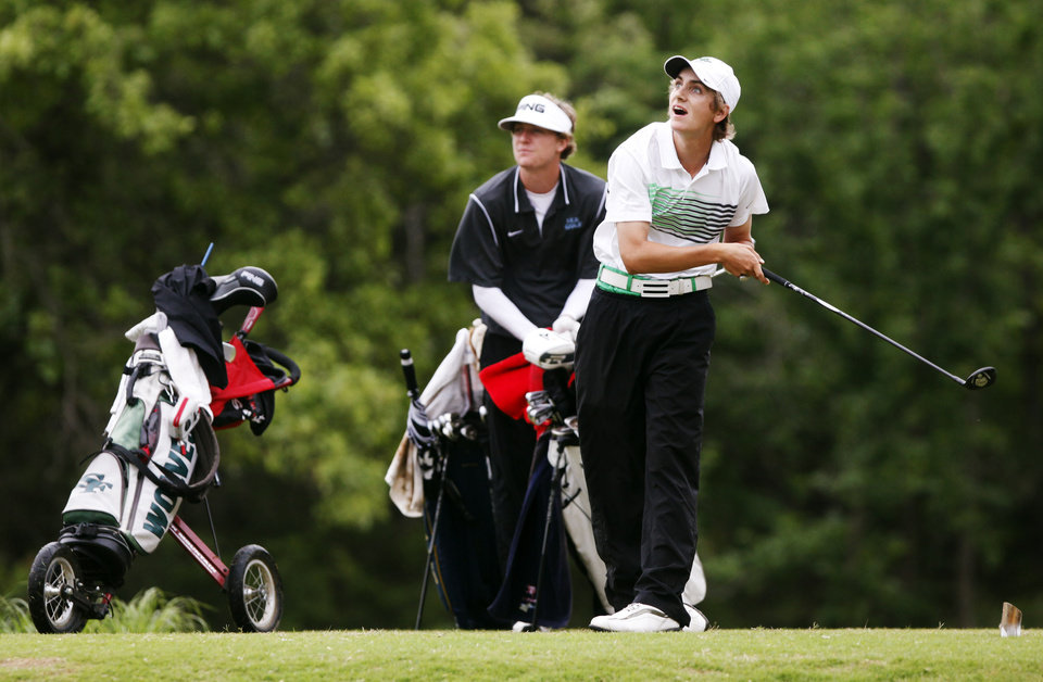 Photo - Drew Ison of Edmond Sante Fe watches his tee shot sail away at the 6A Golf State Championship at Karsten Creek, Monday, May 12, 2014, in Stillwater. Photo by KT King, For The Tulsa World