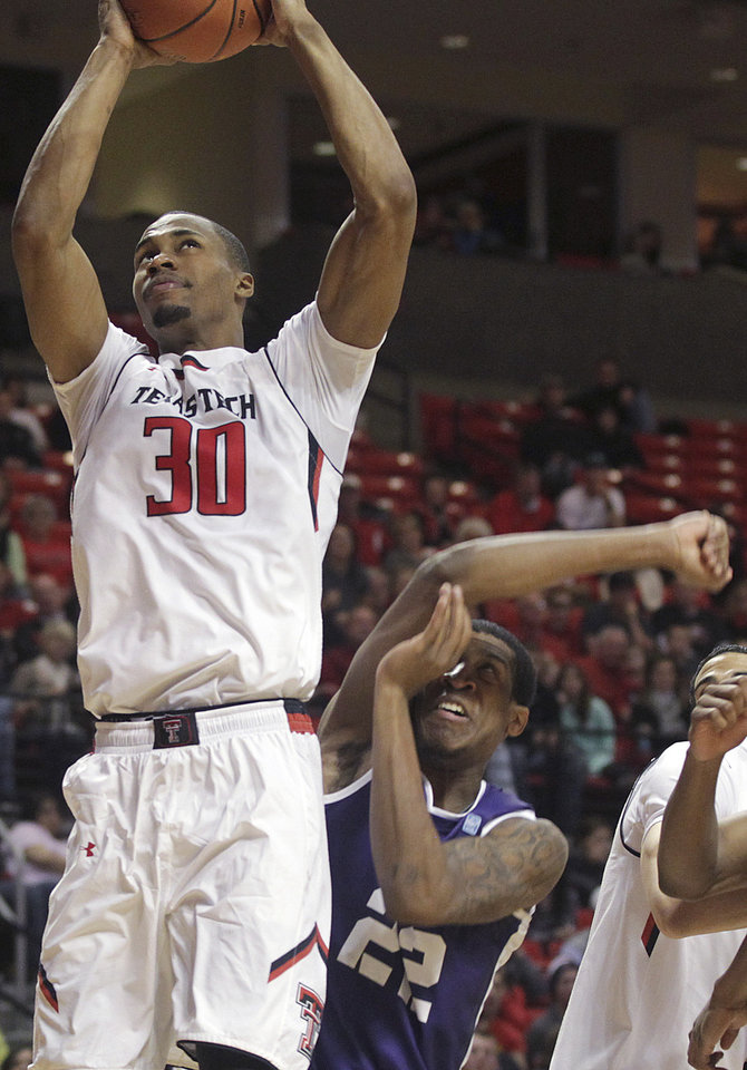 Photo - Texas Tech's Jaye Crockett scores over TCU's Jarvis Ray during an NCAA college basketball game in Lubbock, Texas, Saturday, Feb, 1, 2014. (AP Photo/Lubbock Avalanche-Journal, Tori Eichberger)