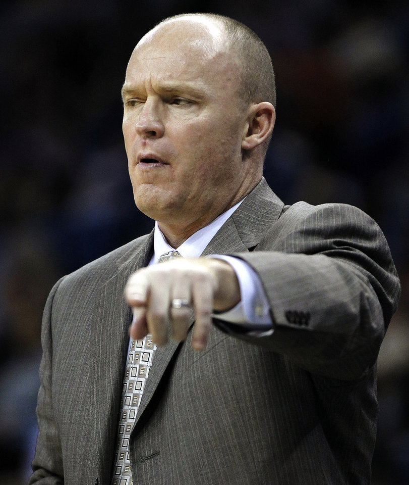 Milwaukee Bucks head coach Scott Skiles calls out in the first half of an NBA basketball game against the New Orleans Hornets in New Orleans, Monday, Dec. 3, 2012. (AP Photo/Gerald Herbert)