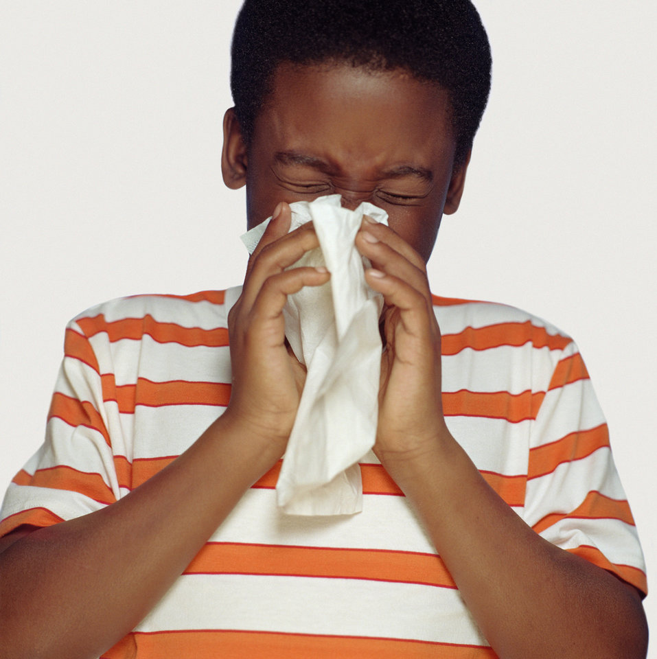 Covering the mouth and nose with a tissue when coughing or sneezing can lessen the spread of flu. <strong>Tom Le Goff</strong>