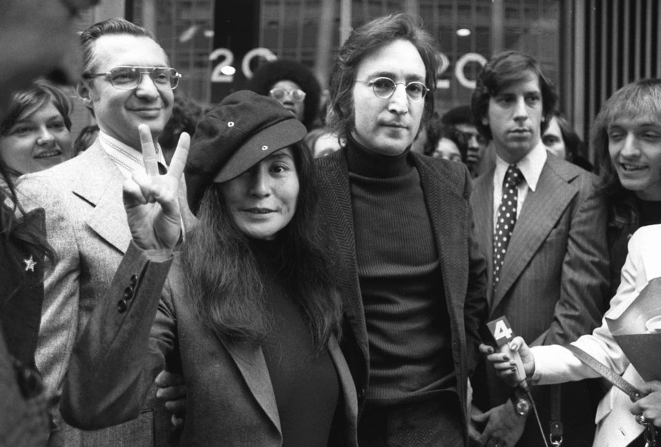 Photo - FILE - In this April 18, 1972, file photo, John Lennon and his wife, Yoko Ono, leave a U.S. Immigration hearing in New York City. The argument over President Barack Obama's legal authority to defer deportations begins 42 years ago with a bit of hashish, a dogged lawyer and, yes, John Lennon and Yoko Ono. Lennon was facing deportation from a Nixon administration eager to disrupt the ex-Beatle's planned concert tour and voter registration drive. The case hinged on Lennon's 1968 conviction for possession of cannabis resin in London. Lennon ultimately succeeded. The case's legacy is an integral part of the legal foundation Obama relied on in 2012 to set up a program that has deferred the deportation of more than 580,000 immigrants who entered the country illegally as children.   (AP Photo)