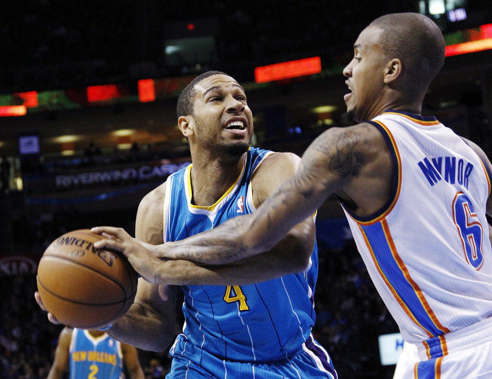 Oklahoma City Thunder guard Eric Maynor (6) knocks the ball away from New Orleans Hornets guard Xavier Henry in the second quarter of an NBA basketball game in Oklahoma City, Wednesday, Dec. 12, 2012. (AP Photo/Sue Ogrocki)