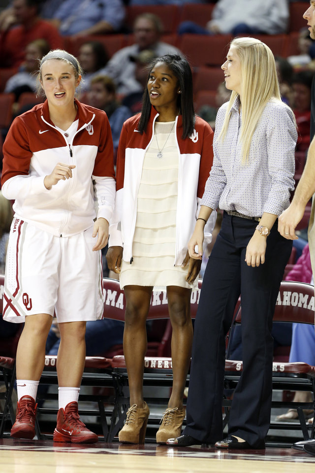 Photo - Oklahoma Sooner's Aaryn Ellenberg, center, wears street clothes on the bench as the University of Oklahoma Sooners (OU) defeat the Kansas Jayhawks 64-61 in NCAA, women's college basketball at The Lloyd Noble Center on Saturday, Feb. 22, 2014  in Norman, Okla. Photo by Steve Sisney, The Oklahoman