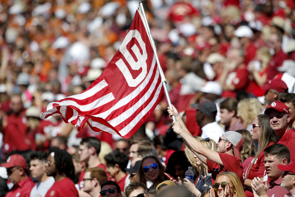 Photo - Fans cheer during the Red River Showdown college football game between the University of Oklahoma Sooners (OU) and the Texas Longhorns (UT) at Cotton Bowl Stadium in Dallas, Saturday, Oct. 12, 2019. OU won 34-27. [Sarah Phipps/The Oklahoman]