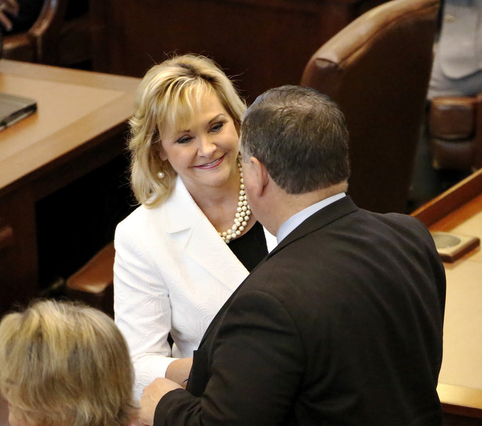 Photo - Gov. Mary Fallin shakes hands with lawmakers in the House of Representatives as she walks through the chamber welcoming each member to the special session. Lawmakers gathered in their respective chambers at the state Capitol Tuesday afternoon,  Sep. 3, 2013, on the first day of a special session called by Gov. Mary Fallin.   Photo  by Jim Beckel, The Oklahoman.