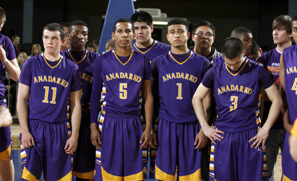 Members of the Anadarko team wait for the trophy presentation after their 86-53 loss to Douglass in the Class 4A boys high school state basketball championship game at State Fair Arena in Oklahoma City, Saturday, March 10, 2012. Photo by Bryan Terry, The Oklahoman
