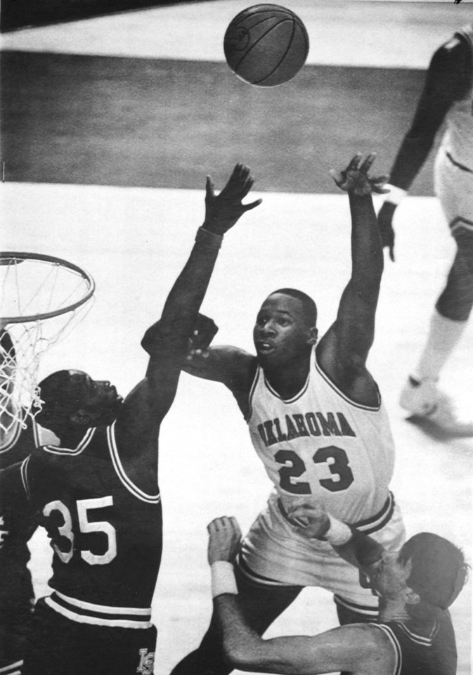 Former OU basketball player Wayman Tisdale. Tulsa, Okla., March 16 - UP WITH THE SHOT -- (Oklahoma Center) Wayman Tisdale, 23, lets go with a shot as Illinois State Forward Derrick Sanders, 35, defends on the play during the first half action Saturday at the NCAA Midwest Regional Basketball Tournament in Tulsa. Oklahoma led Illinois State 65-58 late in the second half. stf/David Longstreath) 1985. 3-17-85 ORG XMIT: KOD