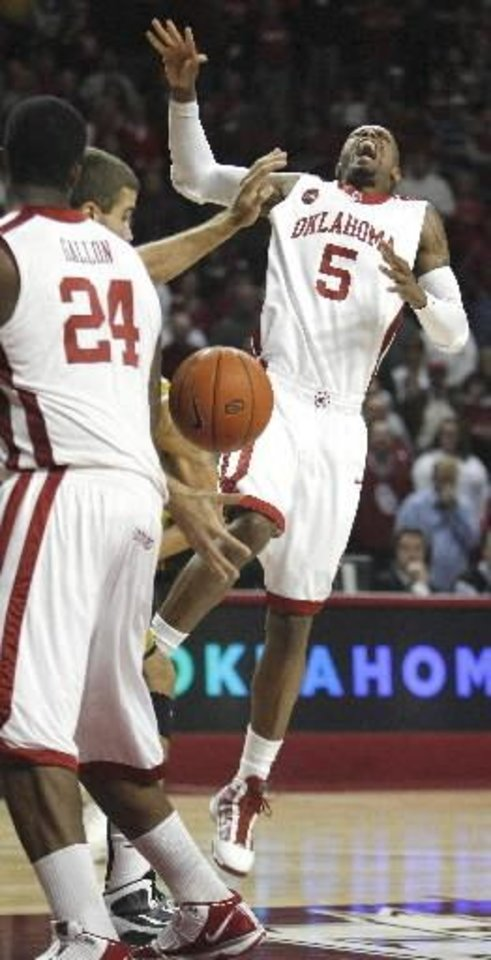 Photo - Sooner  Tony  Crocker is injured on a drive to the basket during the first half of the men's college basketball game between the University of Oklahoma Sooners (OU) and the Missouri Tigers (MU) at the Lloyd Noble Center on Saturday, Jan. 16, 2009, in Norman, Okla. Photo by Steve Sisney