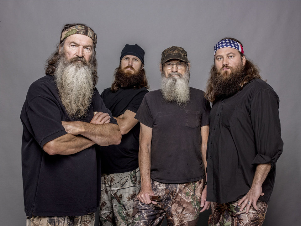 Photo - This 2012 photo released by A&E shows, from left, Phil Robertson, Jase Robertson, Si Robertson and Willie Robertson from the A&E series,