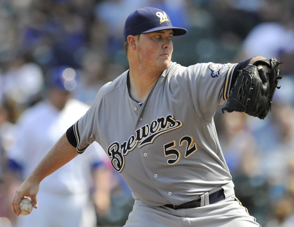Photo - Milwaukee Brewers starter Jimmy Nelson delivers a pitch during the first inning of a baseball game against the Chicago Cubs in Chicago, Monday, Sept. 1, 2014. (AP Photo/Paul Beaty)