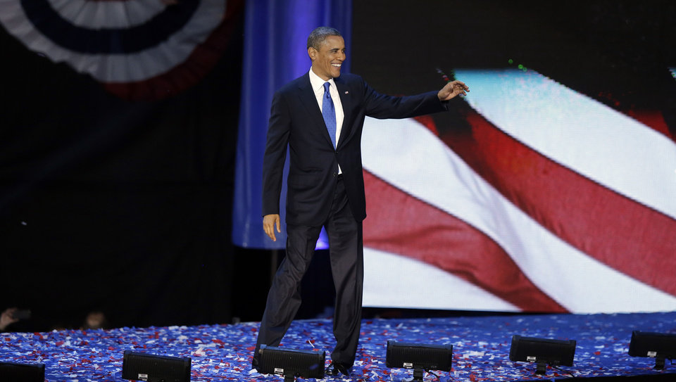 President Barack Obama acknowledges the crowd at his election night party Wednesday, Nov. 7, 2012, in Chicago. President Obama defeated Republican challenger former Massachusetts Gov. Mitt Romney. (AP Photo/Chris Carlson)