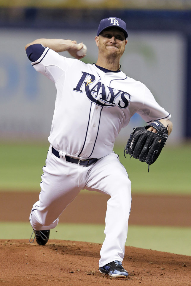 Photo - Tampa Bay Rays starting pitcher Alex Cobb delivers to the Milwaukee Brewers during the first inning of a baseball game Tuesday, July 29, 2014, in St. Petersburg, Fla. (AP Photo/Chris O'Meara)