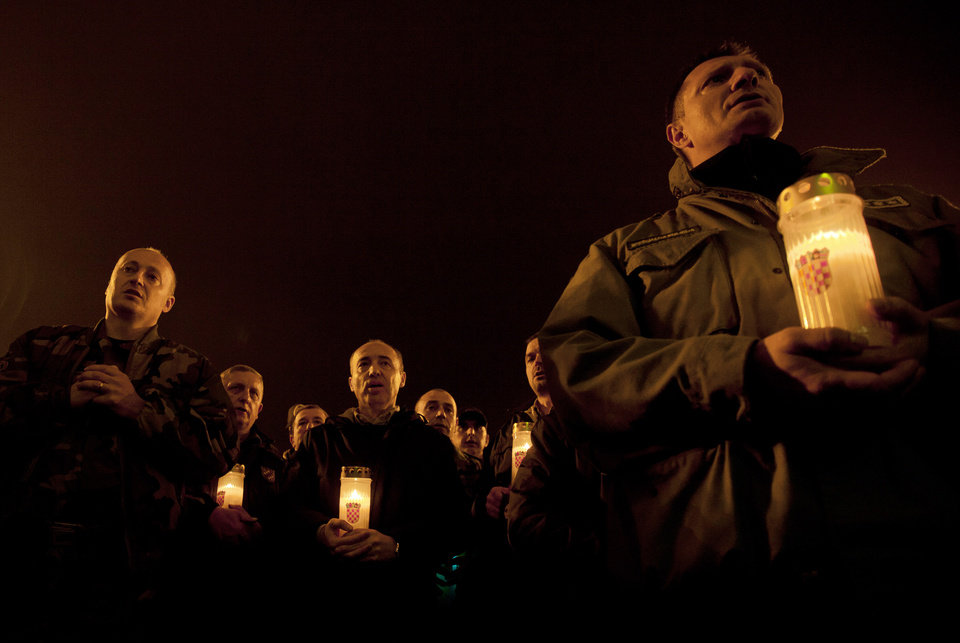 Photo -   Croatian war veterans hold candles during a vigil for Croatian generals Gotovina and Markac, in Zagreb, Croatia, Thursday, Nov. 15, 2012.Thousands of Croatians on Thursday attended Masses and candlelight vigils for their hero, Gen. Ante Gotovina, as they anxiously awaited the outcome of his appeal against a war crimes verdict at a U.N. tribunal.(AP Photo/Nikola Solic)