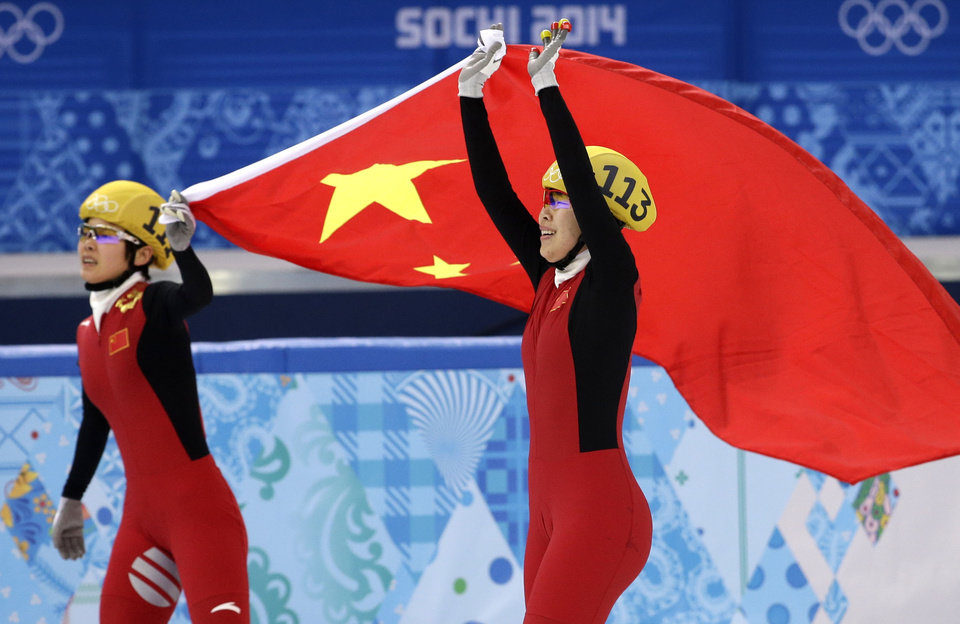Photo - Zhou Yang of China, right, celebrates placing first in a women's 1500m short track speedskating final with Li Jianrou of China, left, at the Iceberg Skating Palace during the 2014 Winter Olympics, Saturday, Feb. 15, 2014, in Sochi, Russia. (AP Photo/Darron Cummings)