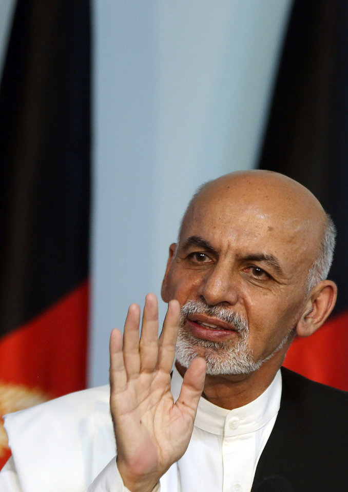Photo - Afghan presidential candidate Ashraf Ghani Ahmadzai addresses a news conference in Kabul, Afghanistan, Tuesday, July 8, 2014. The Afghan Independent Election Commission released preliminary election results Monday showing former finance minister Ashraf Ghani Ahmadzai well in the lead for the presidency but said no winner could be declared because millions of ballots were being audited for fraud.(AP Photo/Massoud Hossaini)