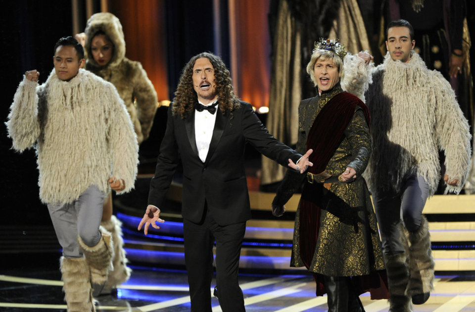 Photo - Weird Al Yankovic, left, and Andy Samberg perform on stage at the 66th Annual Primetime Emmy Awards at the Nokia Theatre L.A. Live on Monday, Aug. 25, 2014, in Los Angeles. (Photo by Chris Pizzello/Invision/AP)