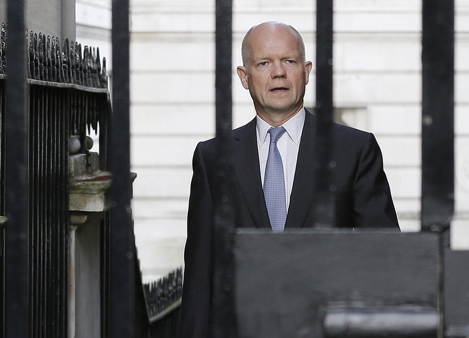 Photo - Britain' Foreign Secretary William Hague walks to Downing Street ahead of a national security meeting to be held at the Cabinet office with Prime Minister David Cameron on the situation in Syria, in London, Wednesday, Aug. 28, 2013. The U.S. and international partners were unlikely to undertake military action before Thursday. That's when Cameron will convene an emergency meeting of Parliament, where lawmakers were expected to vote on a motion clearing the way for a British response. (AP Photo/Alastair Grant)