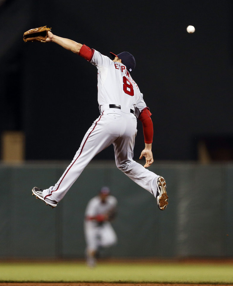 Photo - Washington Nationals second baseman Danny Espinosa is unable to stop a line drive during the eighth inning of a baseball game against the San Francisco Giants, Monday, June 9, 2014, in San Francisco. (AP Photo/Beck Diefenbach)