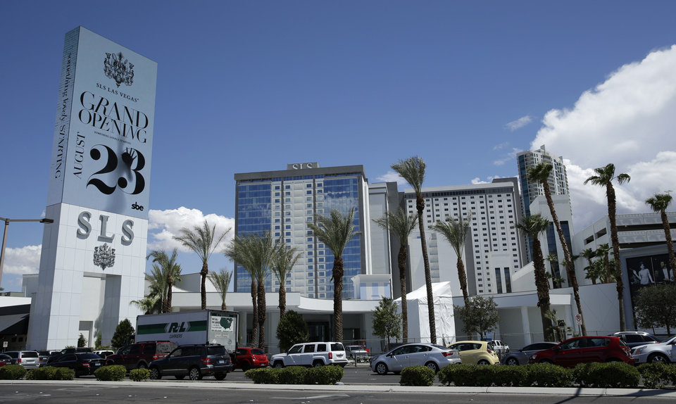 Photo - In this photo taken on Aug. 20, 2014, cars drive past the SLS Las Vegas in Las Vegas. The hotel and casino, formally known as the Sahara, has gone through extensive renovations is scheduled to open this weekend. (AP Photo/John Locher)