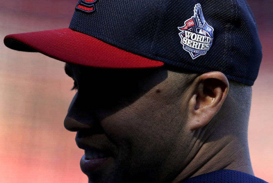 Photo - St. Louis Cardinals' Carlos Beltran wears the World Series logo on his cap during baseball practice Sunday, Oct. 20, 2013, in St. Louis. Beltran is set be part of his first World Series when the Cardinals start play on Wednesday against the Boston Red Sox in Boston. (AP Photo/Jeff Roberson)