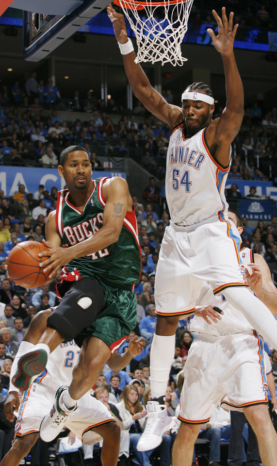 Chris Wilcox (54), of the Thunder, tries to defend on the Bucks' Charlie Bell (42) during the opening NBA basketball game between the Oklahoma City Thunder and the Milwaukee Bucks at the Ford Center in Oklahoma City, Wednesday, October 29, 2008.  BY BRYAN TERRY, THE OKLAHOMAN
