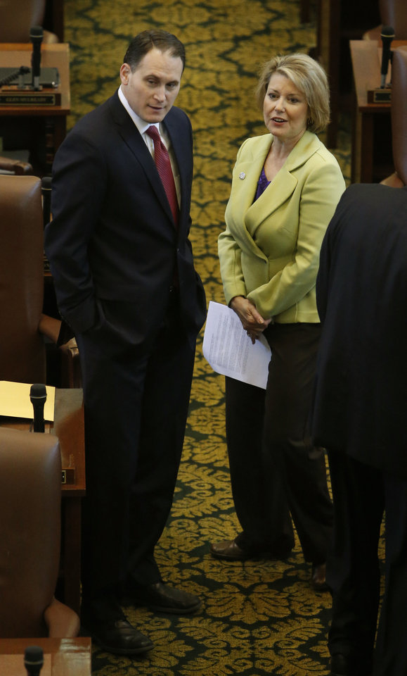 Reps. Scott Martin and Pam Peterson speak on the floor of the House as it takes up the income-tax cutting bill on Wednesday in Oklahoma City.  Photo by Steve Sisney, The Oklahoman <strong>STEVE SISNEY</strong>