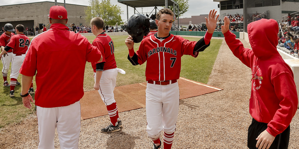 Photo - Verdigris's Ryan Skalnik (7) is greeted with a high five as he returns to the dugout after scoring a run during the 3A baseball semifinal game between Verdigris and Spiro on Friday, May 10, 2013, in Edmond, Okla.Photo by Chris Landsberger, The Oklahoman