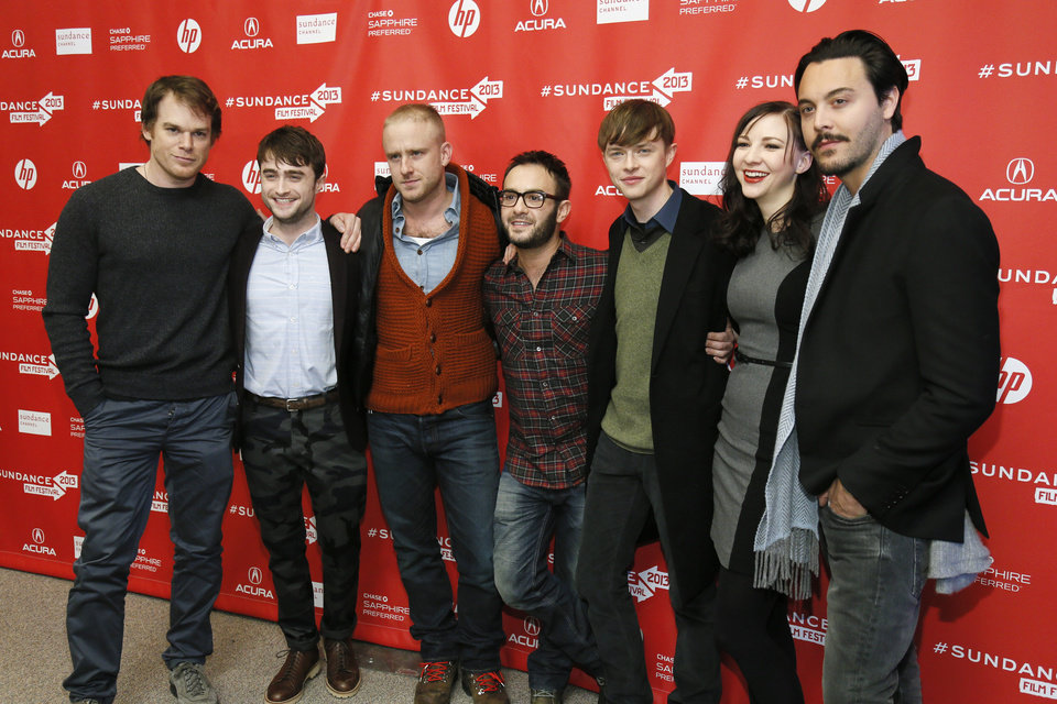 Photo - Cast members from left, Michael C. Hall, Daniel Radcliffe, Ben Foster, director John Krokidas, Dane DeHaan, Erin Darke, and Jack Huston pose together at the premiere of