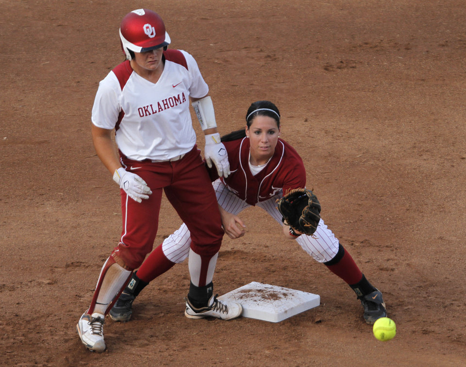 Photo - Oklahoma's Georgia Casey (42) goes to second past Alabama's Danae Hays (15) during a Women's College World Series softball game between OU and Alabama at ASA Hall of Fame Stadium in Oklahoma City, Tuesday, June 5, 2012.  Photo by Garett Fisbeck, The Oklahoman