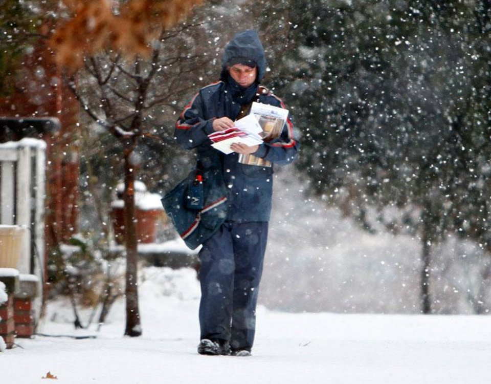 SPS City Carrier Jack Tanksley makes his rounds through falling snow in a neighborhood in downtown Edmond, OK, Tuesday, February 12, 2013,  By Paul Hellstern, The Oklahoman